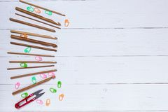 Set of bamboo crochet hooks, color sticker and red snippers Royalty Free Stock Image