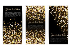 Set banners with confetti stars. Set of vertical banners with bright golden stars of confetti on a dark background Royalty Free Stock Photography