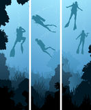 Set banners of divers under water. Set vertical banners of scuba divers under water among coral in cave Stock Photo