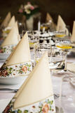 Set banquet table, decorative napkins and glasses with vermouth Royalty Free Stock Photo