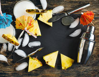 Set of bar accessories and glasses of Pina Colada cocktail. Royalty Free Stock Image