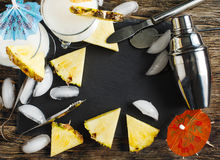 Set of bar accessories and glasses of Pina Colada cocktail. Stock Photo