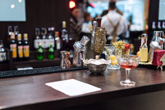 Set of bar accessories and ingredients for making a cocktails on counter. Stock Photo