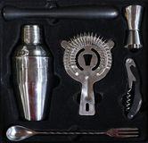 Set of bar tools for cocktails in a black box. Utensils for mixing drinks royalty free stock photos