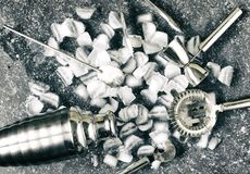 Set of bar tools for making a cocktails arranged on a stone background. Top view stock images