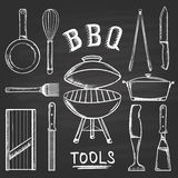 Set of barbecue tools drawn in chalk on a blackboard. Hot brazier, grater to peel, blender, frying pan, tongs, knife, slicer. Royalty Free Stock Images