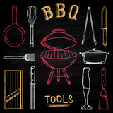 Set of barbecue tools drawn in colored chalk on a blackboard. Hot brazier, grater to peel, blender, frying pan, tongs, knife. Royalty Free Stock Photography