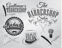 Set Barbershop signs. Coal. Set Barbershop, scissors, shaving brush, razor, cylinder, in a retro style and stylized for the drawing with coal on the board Stock Photography