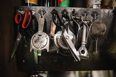 Set of barman equipment hanging. On working place Stock Images
