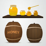 A set of barrels of honey for the apiary and cans that are on th Royalty Free Stock Photo