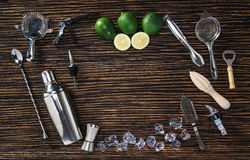 Set of bartending tools and limes Royalty Free Stock Photo