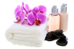 Set basalt stones, towel and orchid. Royalty Free Stock Photography