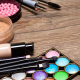 Set of basic make-up products on wooden surface royalty free stock image