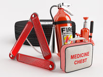 Set of basic necessities. A set consisting of a wheel, fire extinguisher, first aid kit, warning triangle and jack Royalty Free Stock Photos