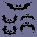 Set of bats for Halloween. Set of bats flapping wings on a dark blue background with illustrations of Halloween Royalty Free Stock Images
