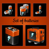 Set of batteries on a brown background. Five icons Royalty Free Stock Images
