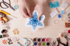 Set for beading. Beaded snowflakes for Christmas tree. Preparation for handmade, top view on the table Royalty Free Stock Image