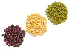 Set beans isolated on white background. Flat lay composition with different types of beans:  peas, red beans and mung beans. stock images