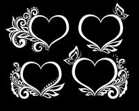 Set of beautiful black-and-white symbol of a heart with floral design and butterfly. Royalty Free Stock Images