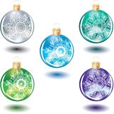 Set of beautiful Christmas glass balls with decora. Tion over white Stock Photos