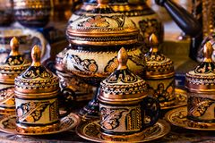 Set of beautiful coffee cups and pots with golden traditional eastern ornaments stock image