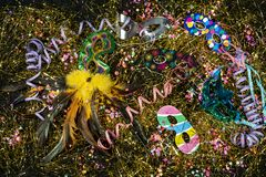 Set of beautiful and colorful carnival masks and parties on a background of confetti royalty free stock images