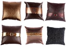 Luxurious Designer Pillows. A set of beautiful designer pillows with inticrate designs, on white studio background Stock Photography