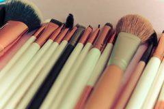A set of beautiful different soft brushes for make-up from natural nap for beauty targeting and applying a tonal foundation royalty free stock images