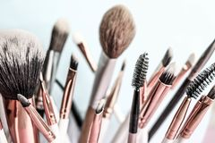 A set of beautiful different soft brushes for make-up from natural nap for the guidance of beauty and the application stock photo