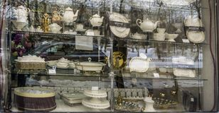 a set of beautiful dishes in the window of one shop stock photo