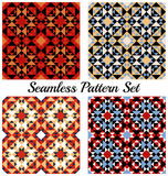 Set of 4 beautiful geometric patterns with triangles and squares of red, orange, blue, white, black and beige shades Royalty Free Stock Photography