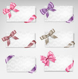Set of beautiful gift cards with colorful gift bow Stock Photo