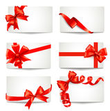 Set of beautiful gift cards with red gift bows Stock Photo