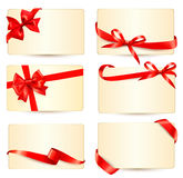Set of beautiful gift cards with red gift bows wit Royalty Free Stock Images