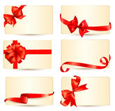 Set of beautiful gift cards with red gift bows wit Stock Photos