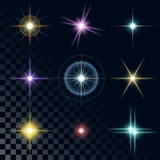 Set of beautiful multicolored stars. Set of the realistic beautiful multicolored star fires and flashes on a transparent background a vector illustration. Blue Royalty Free Stock Image