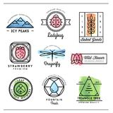 Set of beautiful nature inspired, watercolor geometric logos and Royalty Free Stock Photography