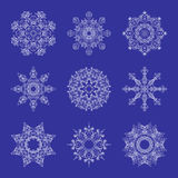 Set of Beautiful Openwork Snowflakes. White Snowflakes on Blue Background.  Elements for Christmas and New Year Design Royalty Free Stock Photos