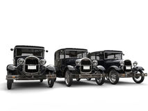 Set of beautiful 1920s vintage cars. Isolated on white background Stock Photography