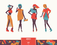 Set with beautiful stylish fashion girls posing. Vector geometric low poly illustration with vogue women silhouettes with bright c. Lothing and various poses Royalty Free Stock Image