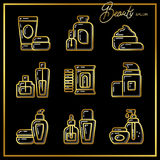 Set of beauty cosmetics icons drawn in gold lines on a black bac Stock Photography