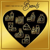 Set of beauty cosmetics icons drawn in gold lines on a black hea Stock Photography