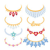 Set of beautyful golden necklaces with gemstones. Stock Images