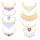 Set of beautyful golden necklaces with gemstones. Royalty Free Stock Photos