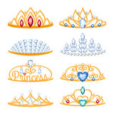 Set of beautyful golden tiaras with gemstones. Royalty Free Stock Images