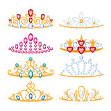 Set of beautyful golden tiaras with gemstones. Royalty Free Stock Photo