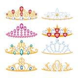 Set of beautyful golden tiaras with gemstones. Royalty Free Stock Photo