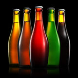 Set of beer bottles isolated on black background Royalty Free Stock Photography