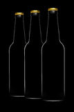 Set of beer bottles isolated on black background Stock Photography