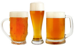 Set of Beer. Set of Glasses Fresh Pils Beer with froth and condensed water pearls isolated on white background with clipping path. High Quality XXXL Royalty Free Stock Image